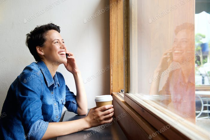 Young woman talking on mobile phone at cafe