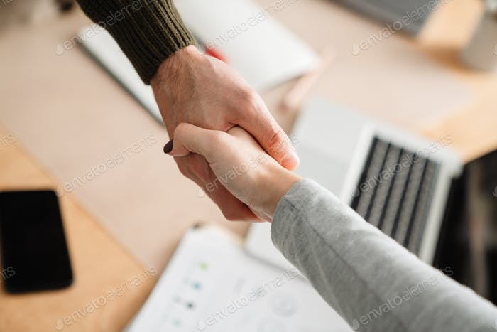 Close up of a colleagues handshake