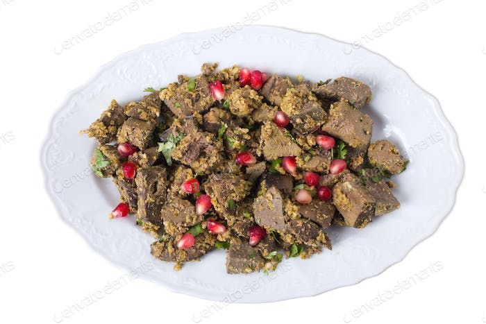 Baked beef liver with walnuts.