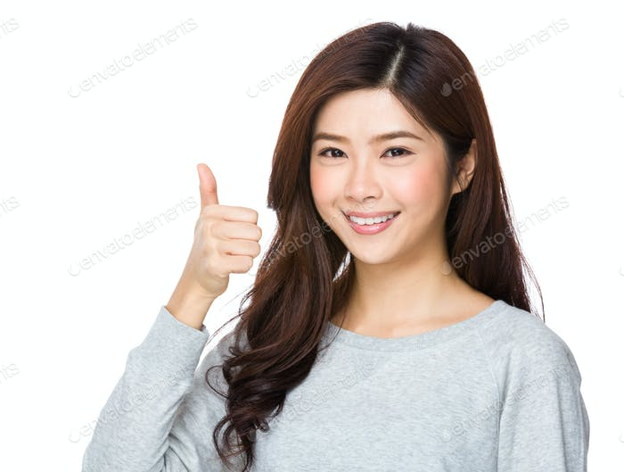 Young asian woman showing thumbs up