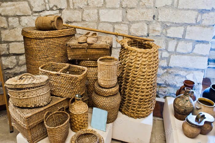 A lot of handmade wickerworks at an exhibition in the museum.
