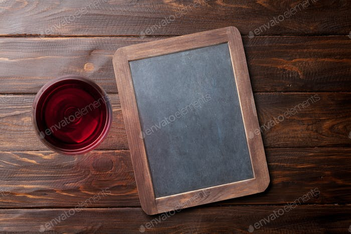 Red wine glass and chalkboard