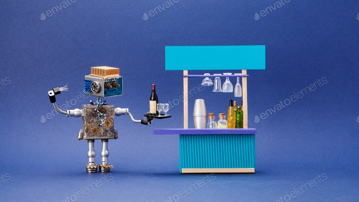 Steampunk style bartender waiter robotic toy holds tray with oder wine bottle and glasses.