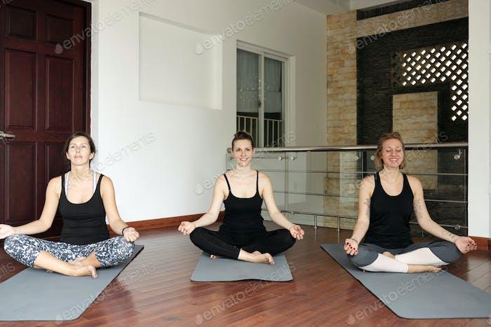 Fit Women in Lotus Position