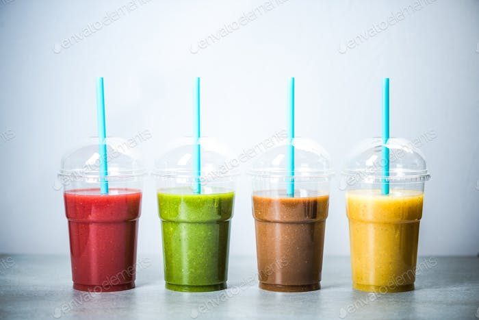 Healthy diet smoothie in four colors