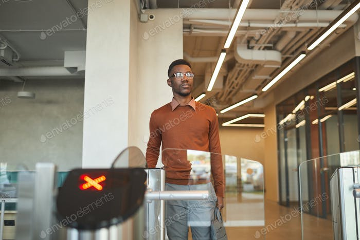 African-American Man Passing Turnstile