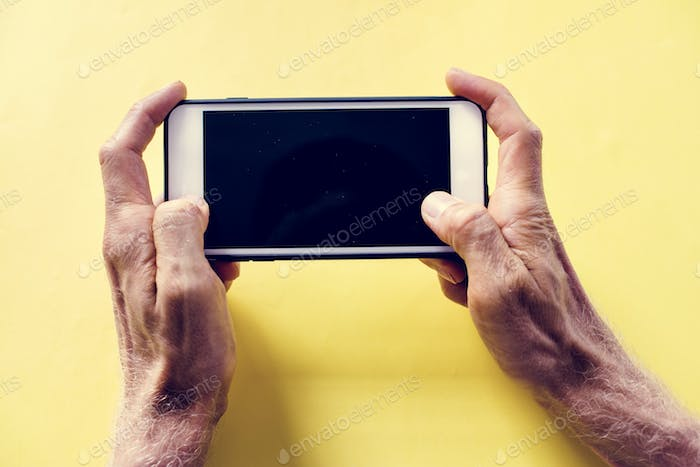 Hands holding smartphone isolated on a background