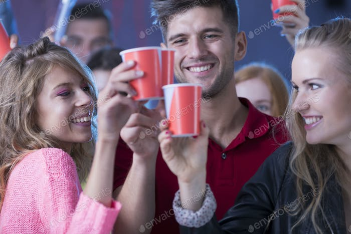 Young happy  friends during party