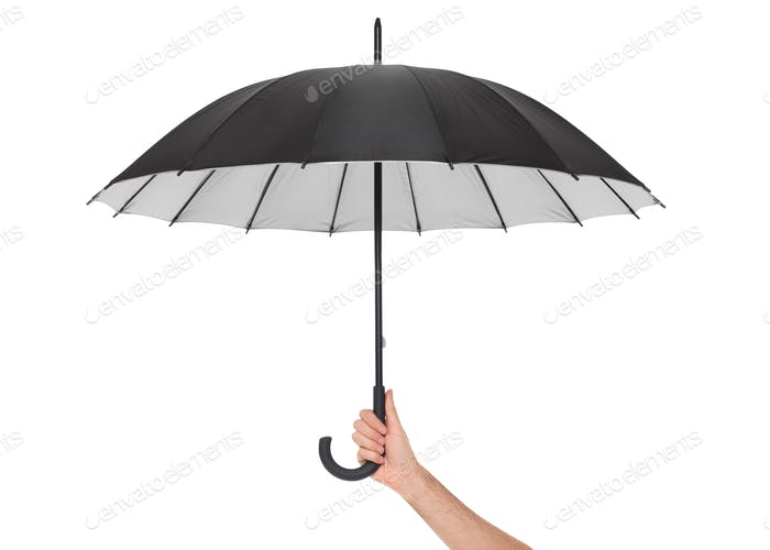Hand holding black umbrella isolated on white, clipping path inc