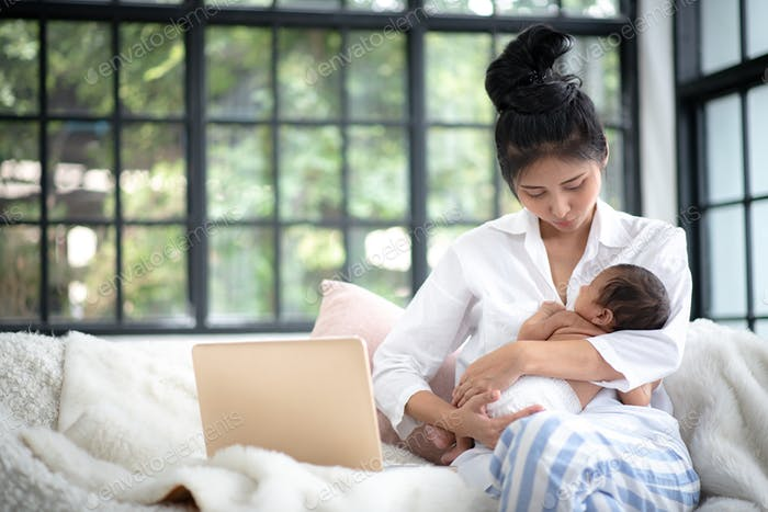 Adolescent mother is breastfeeding a baby.