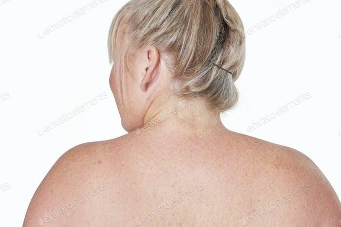 Curvy woman facing back bare skin