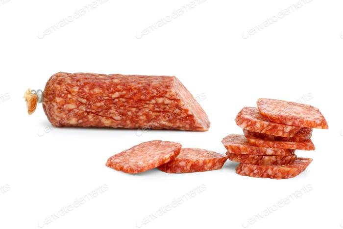 Half of salami sausage and slices near