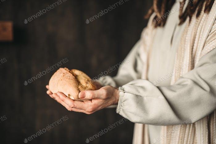 Jesus Christus mit Brot in den Händen, heilige Speise