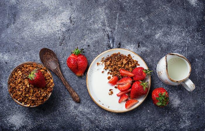 Granola with yogurt and strawberries