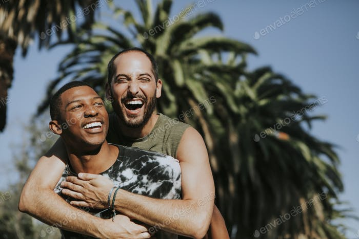 Gay couple hugging in the park