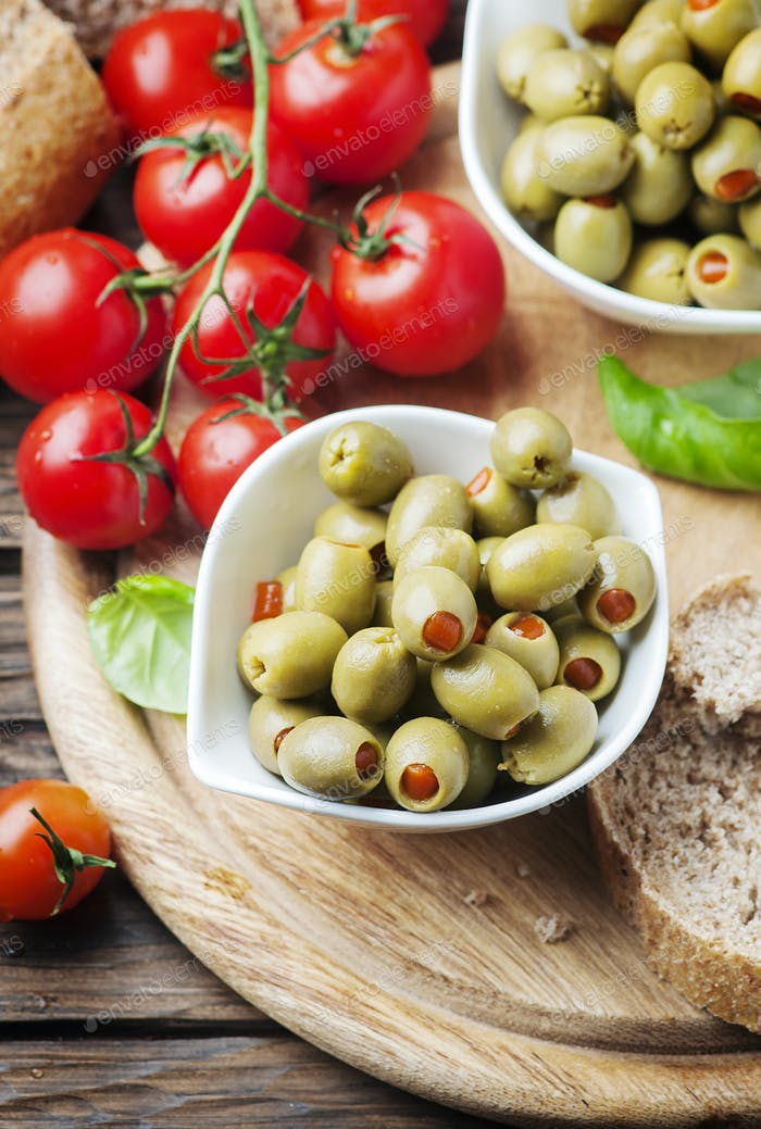 Spanish olives on the wooden table
