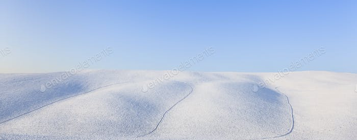 Panoramic snow rolling hills landscape in winter. Tuscany, Italy