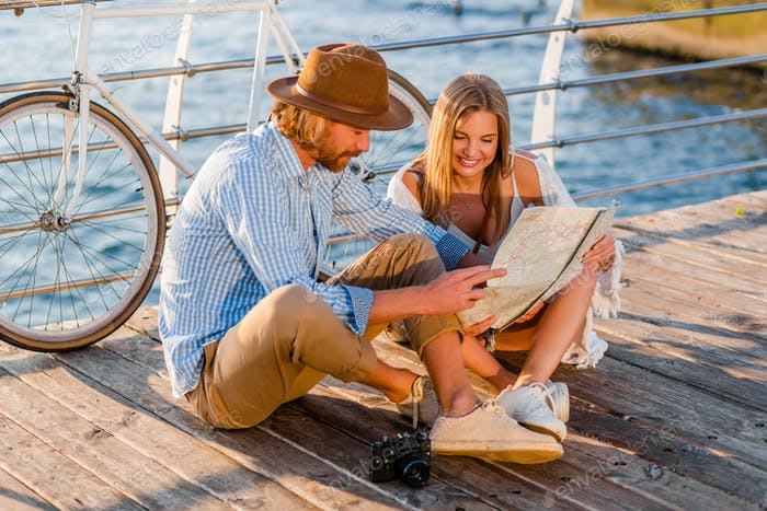 attractive happy smiling couple traveling in summer by sea