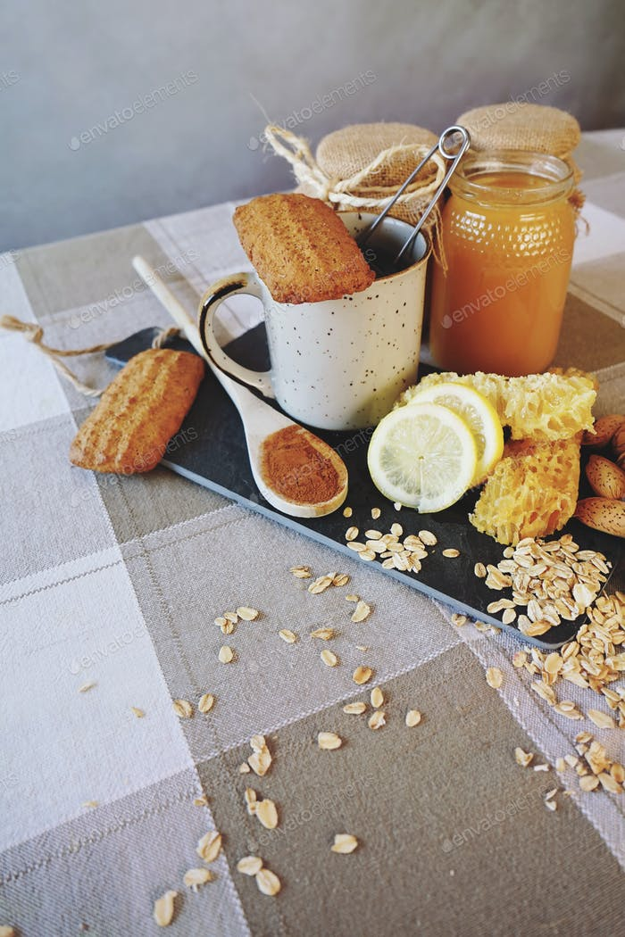 Healthy breakfast with tea, lemon and honey