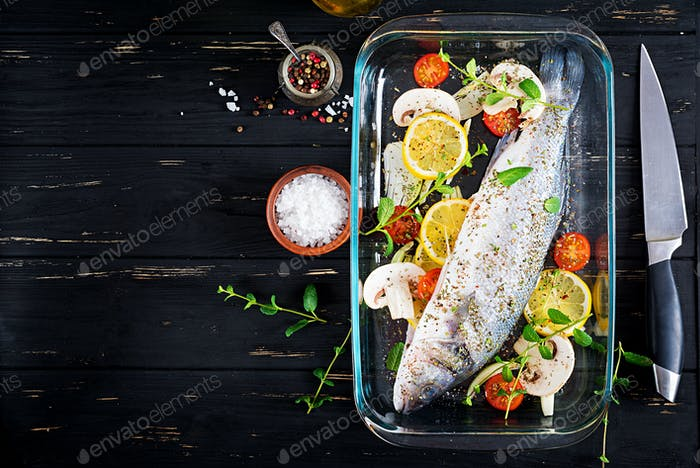 Raw fish. Sea bass on baking dish. Ingredients for cooking, grill, baked. Copy space. Top view