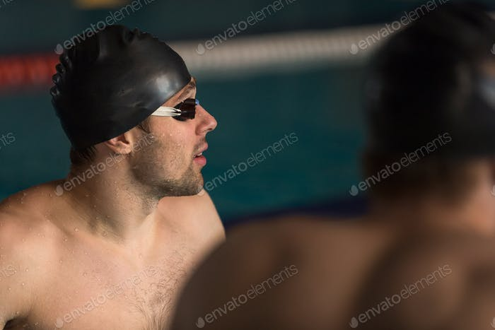 Close up of a swimmer in cap and swimming goggles