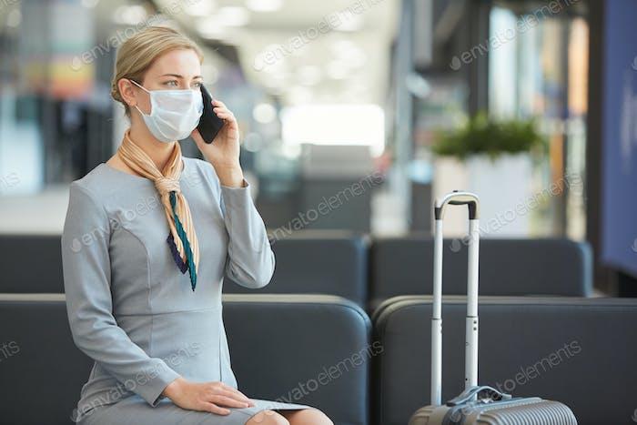 Elegant Woman Wearing Mask in Waiting Lounge