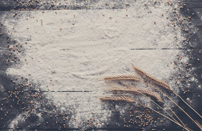 Baking concept on wood background, sprinkled flour with copy space