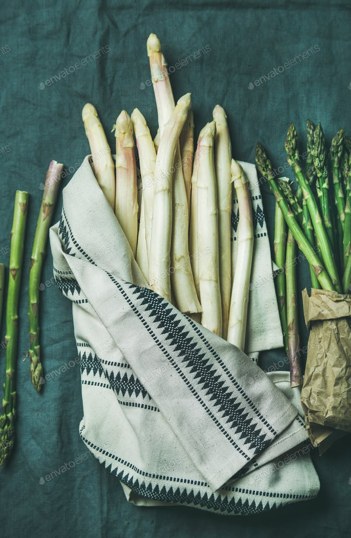 Fresh green and white asparagus in towel, top view