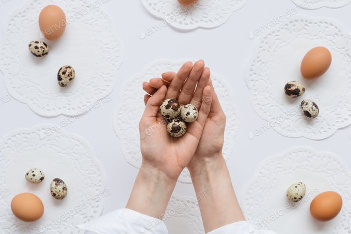 Woman Holding Quail Eggs in Hands