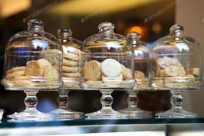 Shortbread Italian style cookies on retail display in glass boxes in store or bakery through window