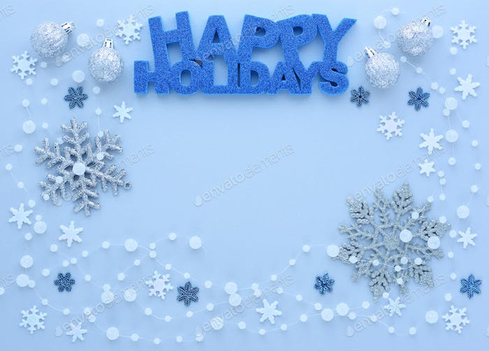 "Christmas or New Year greeting card. Greeting ""Happy Holidays""  and snowflakes"