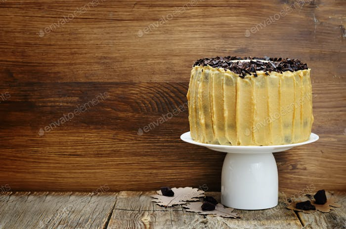 Pumpkin and chocolate layer cake with salted caramel cream chees