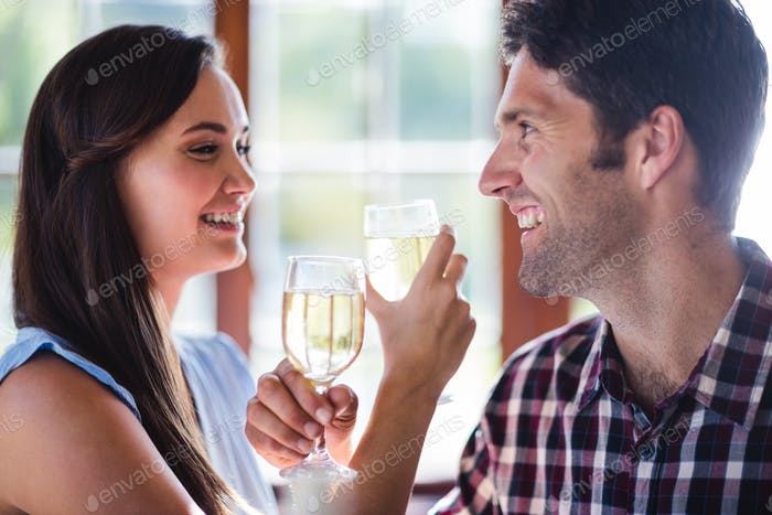 Close-up of couple having white wine in restaurant