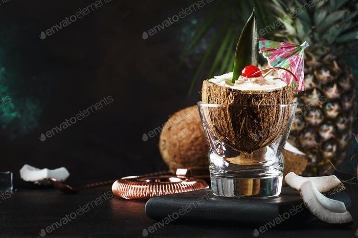 Pina Colada Cocktail in chopped coconut with tropical fruit