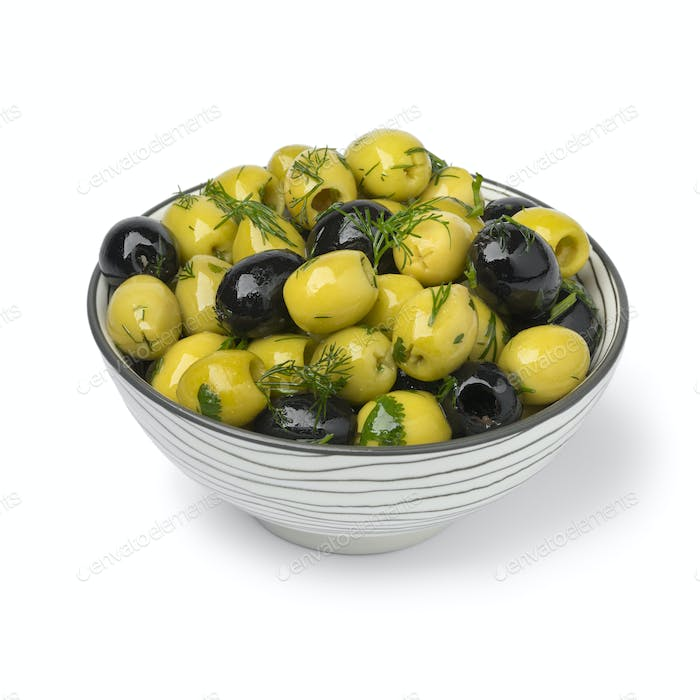Bowl with green and black olives close up