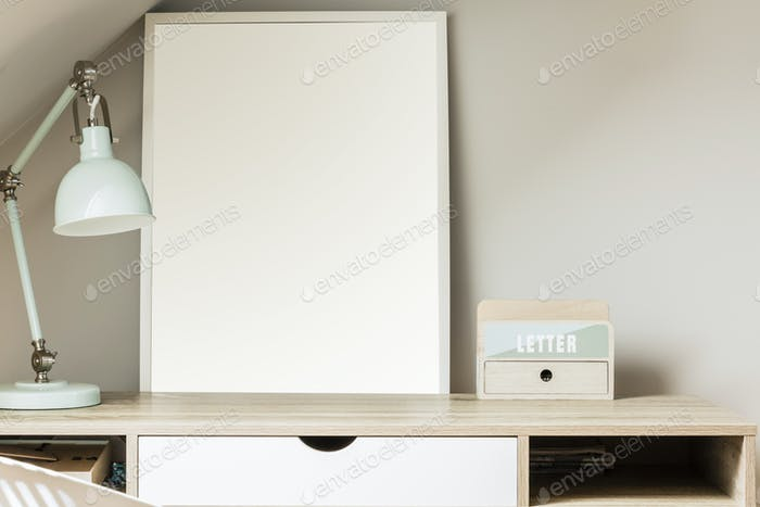 Real photo with close-up of wooden desk with pastel mint lamp, p