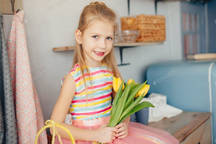 Cute little girl with a yellow flowers