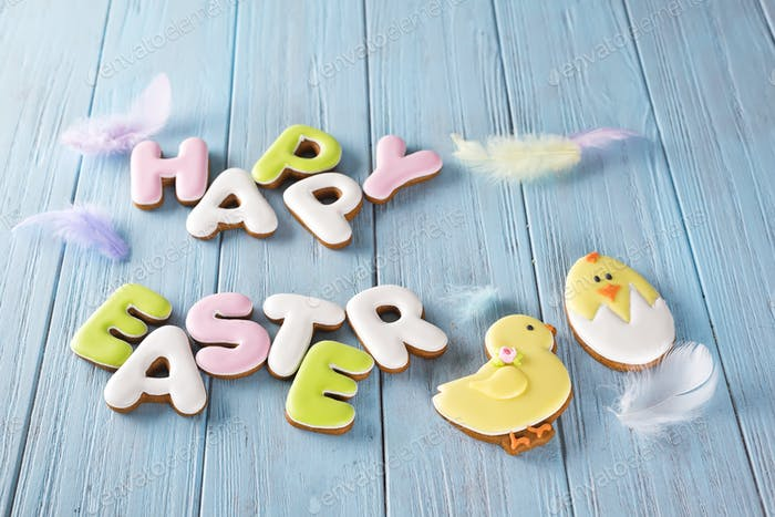 Easter chicken cookies end cookies letter Happy Easter on wood background