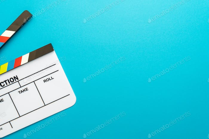 Top View Of Open White Clapperboard On Turquoise Blue Background And Copy Space