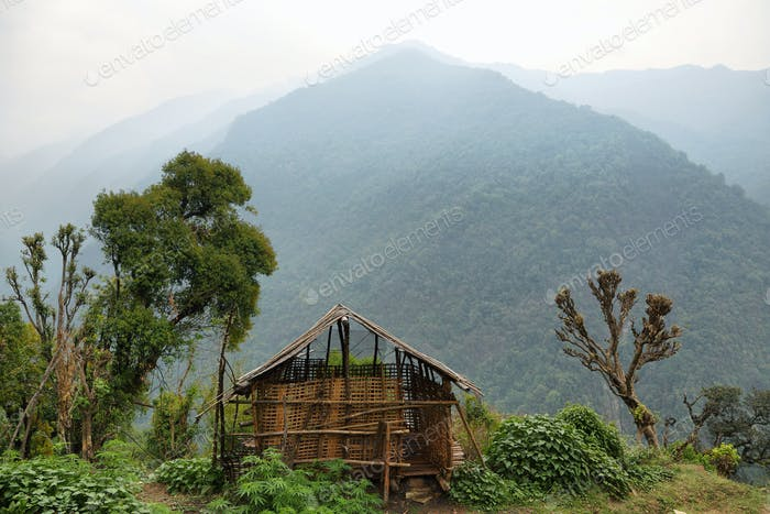 Barn and foggy mountains in Nepal