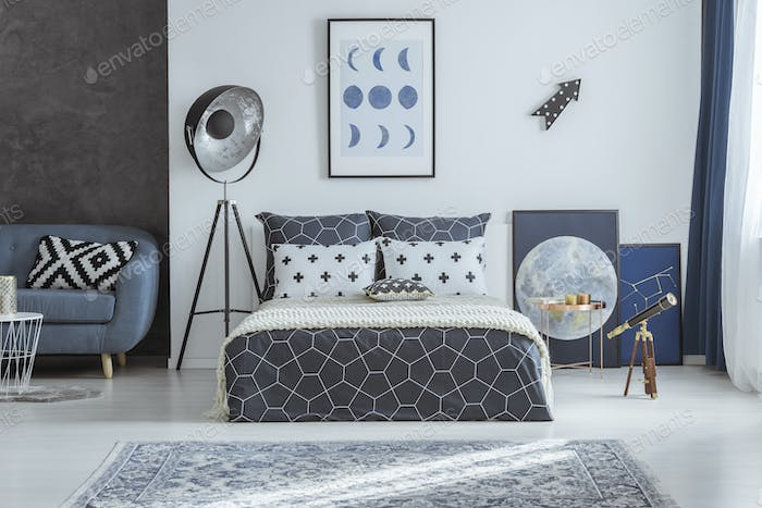 Spacious blue bedroom with telescope