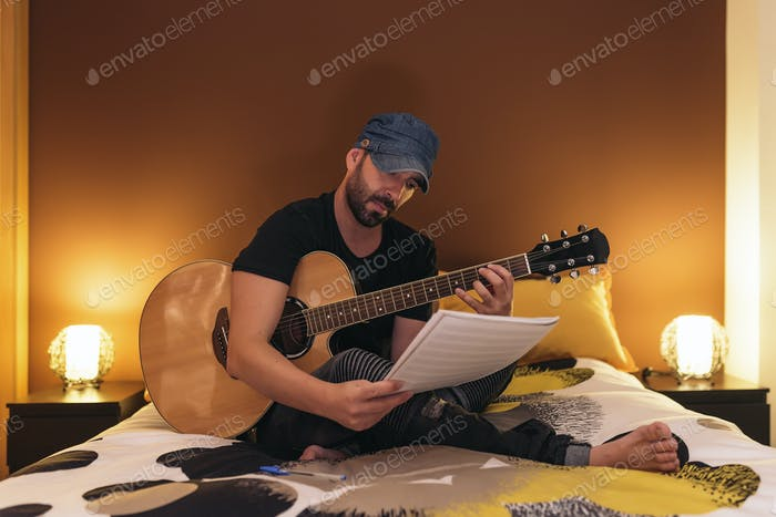 Young man composing music.