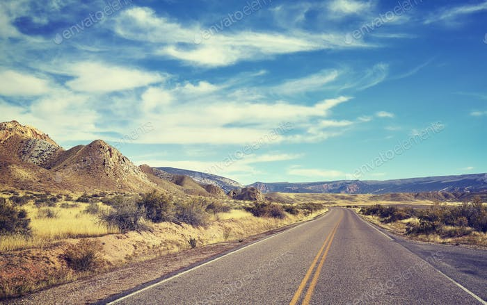 Color toned endless road, travel concept picture, USA