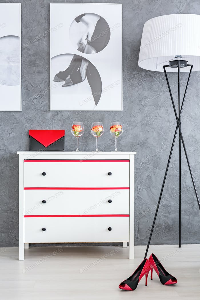 Red and black accessories in bedroom