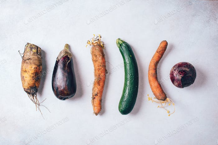 Ugly organic farm vegetables with mutations on craft paper background. Concept of zero waste