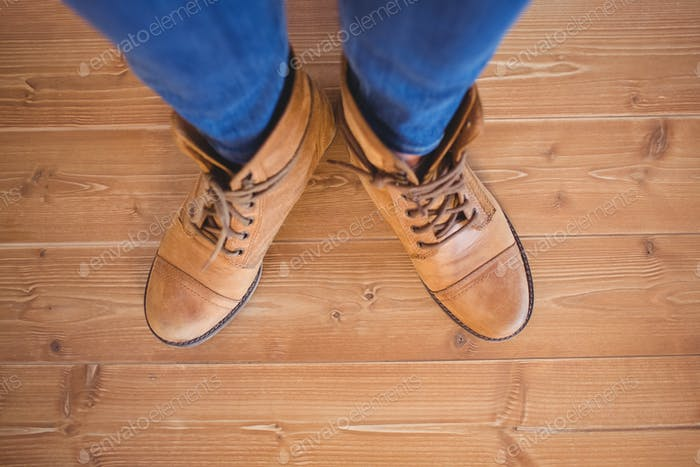 Thumbnail for High angle view of woman wearing boots on wooden planks background