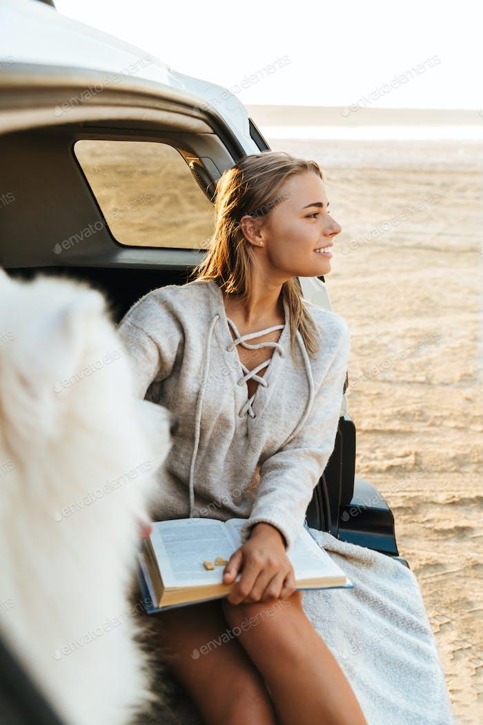 Woman with dog samoyed outdoors