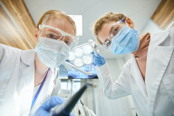 Two dentists working in team