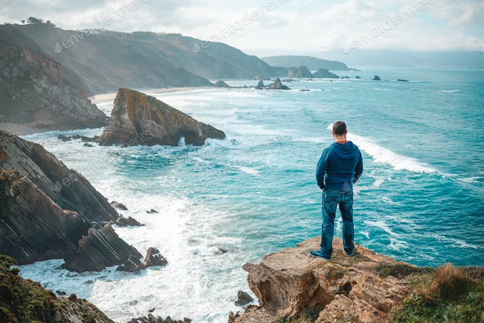 One man enjoying the view of the cliffs of Loiba, Galicia