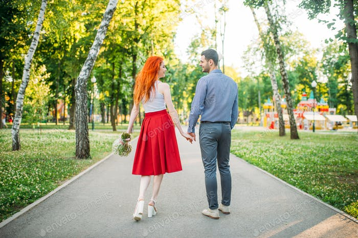 Romantic date, love couple walk in park, back view